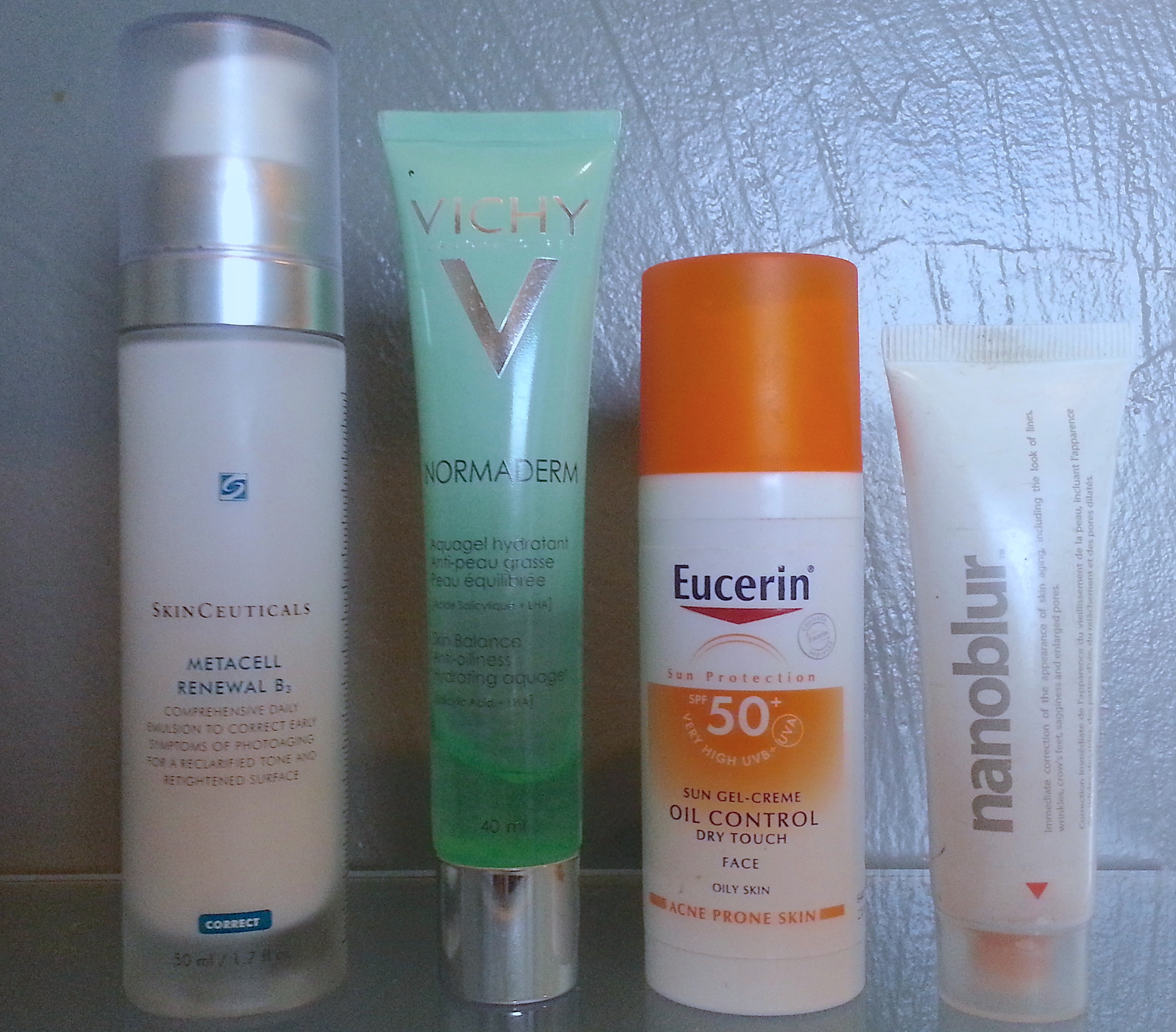 From left: SkinCeuticals Metacell Renewel B3; Normaderm Aquagel hydratant; Eucerin oil control sun gel-creme, SPF 50+; Nanoblur corrector (discontinued).